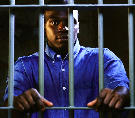 Black_man_behind_bars